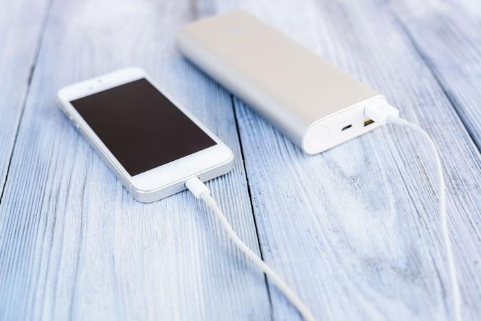Powerbank charging white smartphone